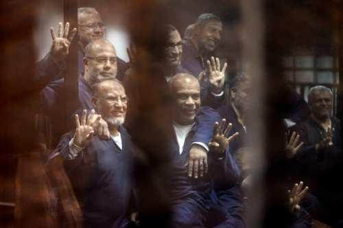 Senior political figures of the Muslim Brotherhood Saad El-Katatni (2nd L) gesture during a trial session over the Wadi el-Natrun prison case at Cairo Police Academy in Egypt on 26 February, 2017 [Moustafa El Shemy/Anadolu Agency]