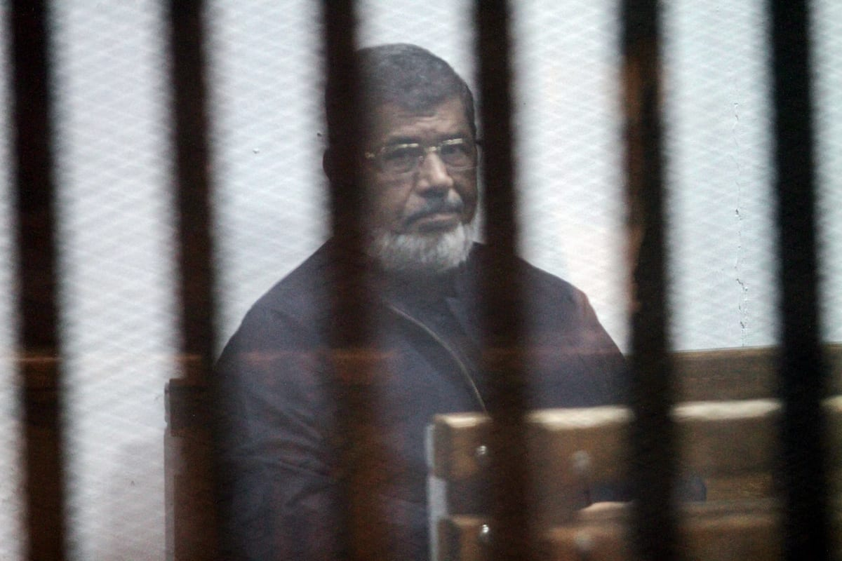 Egypt's ousted President Mohamed Morsi attends a trial session over the Wadi el-Natrun prison case at Cairo Police Academy in Egypt on 26 February, 2017. ( Moustafa El Shemy - Anadolu Agency )