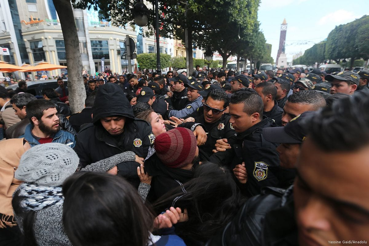 Police officers block the road as Tunisians stage a protest demanding employment, at the in Tunis, Tunisia on 1 February 2017 [Yassine Gaidi - Anadolu Agency]
