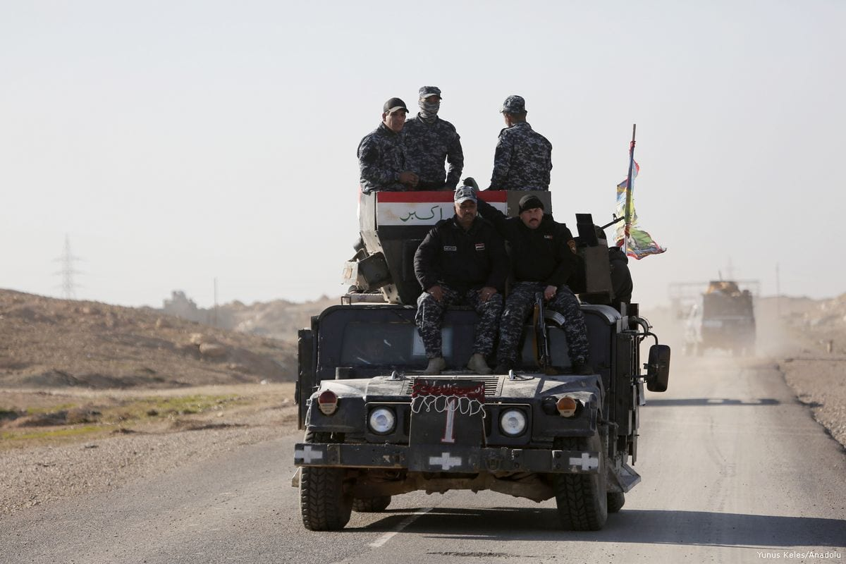 Iraqi security forces are seen on a military vehicle as the operation to retake Mosul from Daesh continues on 20 February, 2017 [Yunus Keleş/ Anadolu Agency]