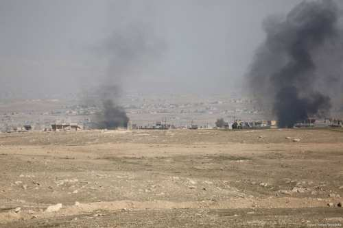Smoke rises as Iraqi security forces attack Daesh h in Mosul, Iraq on 20 February 2017 [Yunus Keleş/Anadolu Agency]
