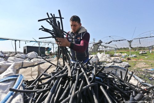 Many Palestinians in the Gaza Strip gather plastics from rubbish dumps ready for it to be recycled [Mohammed Asad/Middle East Monitor]