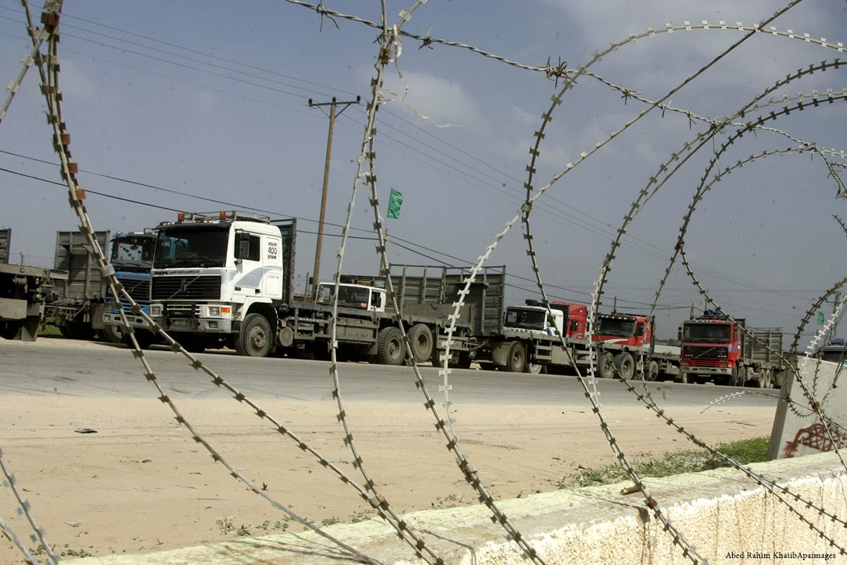 Palestinians stop with their lorries near the crossing of the Israeli crossing Kerem Shalom [Abed Rahim KhatibApaimages]
