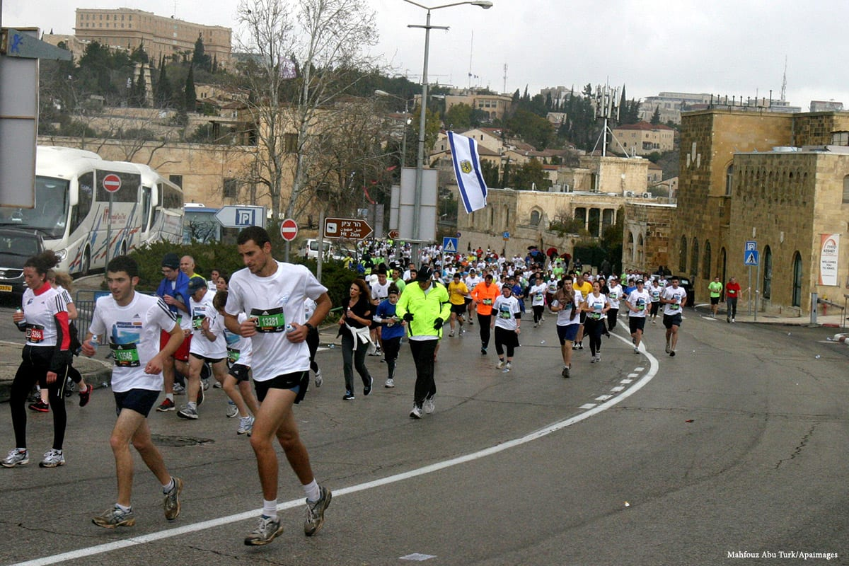 Image of a marathon taking place in the Old City of Jerusalem [Mahfouz Abu Turk/Apaimages]
