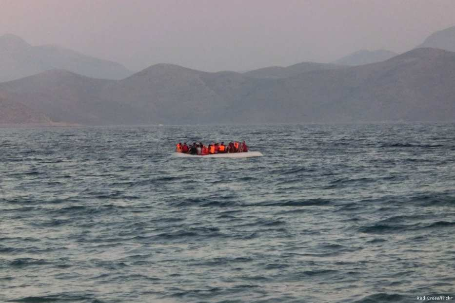 A rubber boat carrying around fifty migrants and refugees [Red Cross/Flickr]