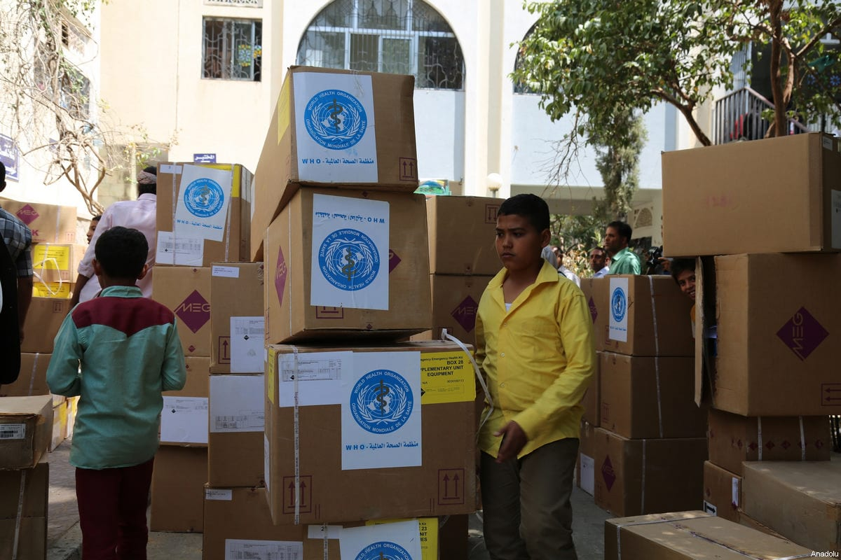 Yemeni people carry the humanitarian aids including medical equipments and medicines distributed by United Nations at the Al Tavun hospital in Taiz, Yemen on 4 March, 2017 [Abdulnasser Alseddik/Anadolu Agency]