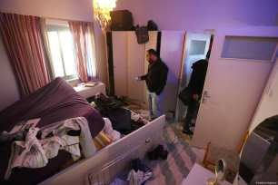 RAMALLAH, WEST BANK - MARCH 6: A man inspects the room of Basil Al-Araj's house after Israeli soldiers stormed into and open fire on Basil Al-Araj's house, 31, in Ramallah, West Bank on March 6, 2017. After Israeli forces stormed into Israeli's houses Basil Al-Araj killed and 2 others injured. ( Issam Rimawi - Anadolu Agency )