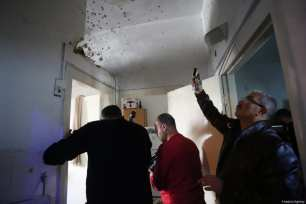 RAMALLAH, WEST BANK - MARCH 6: Men take photos of bullet marks after Israeli soldiers stormed into and open fire on Basil Al-Araj's house, 31, in Ramallah, West Bank on March 6, 2017. After Israeli forces stormed into Israeli's houses Basil Al-Araj killed and 2 others injured. ( Issam Rimawi - Anadolu Agency )
