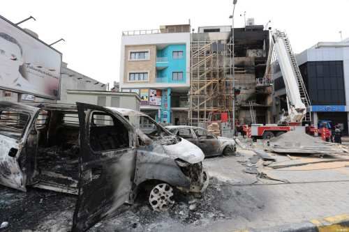 Burnt vehicles are seen after Tripoli-based salvation government's TV channel were burned down by a group of gunmen in Tripoli, Libya on March 15, 2017 [Hazem Turkia / Anadolu Agency]