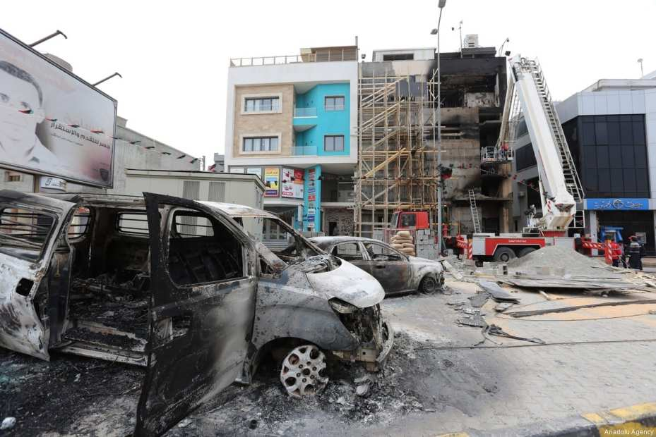 TRIPOLI, LIBYA - MARCH 15: Burnt vehicles are seen after Tripoli-based salvation government's TV channel was burned down by a group of gunmen in Tripoli, Libya on March 15, 2017. ( Hazem Turkia - Anadolu Agency )