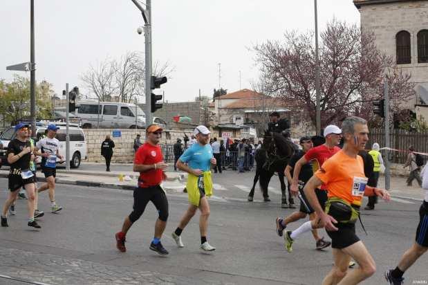 Participants compete during the 7th annual International Jerusalem Marathon in Jerusalem on March 17, 2017. [Mostafa Alkharouf / Anadolu Agency]