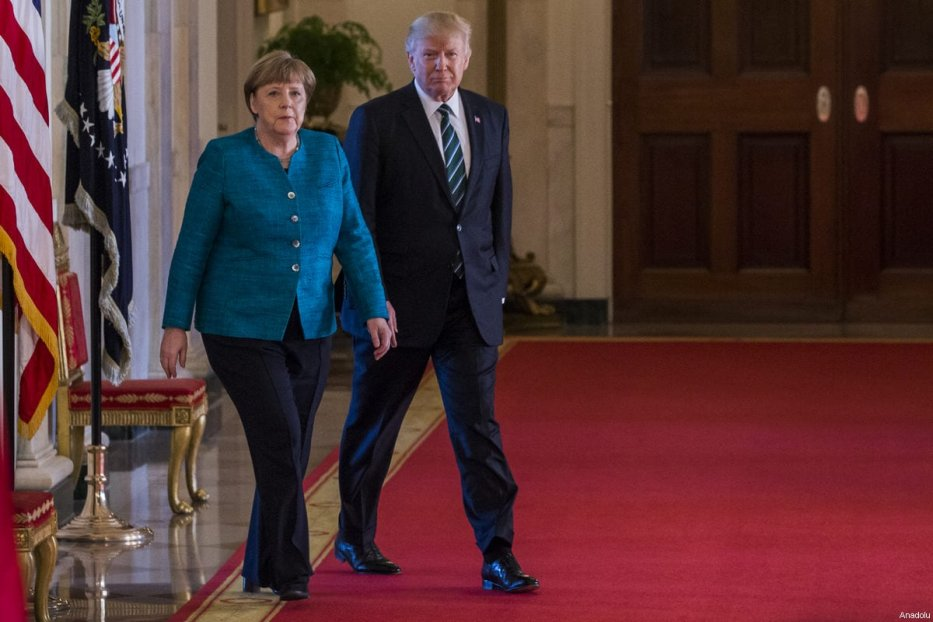 US President Donald Trump and German Chancellor Angela Merkel walk down the cross hall to a joint press conference at the White House during Chancellor Merkel's visit to Washington, USA on 17 March 2017. [Samuel Corum - Anadolu Agency]