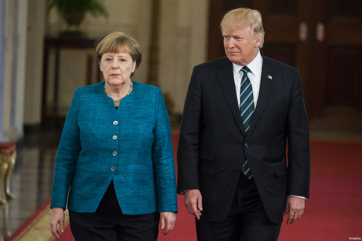 US President Donald Trump (R) and German Chancellor Angela Merkel (L) walk down the cross hall to a joint press conference at the White House during Chancellor Merkel's visit to Washington, United States on 17 March 2017. [ Samuel Corum - Anadolu Agency]