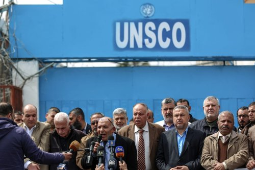 """Palestinians gather in front of the UNESCO office in protest after UN Secretary-General Antonio Guterres forced UN Under-Secretary-General Rima Khalaf to withdraw a report accusing Israel of imposing an """"apartheid"""" regime, in Gaza City, Gaza on March 21, 2017. ( Ali Jadallah - Anadolu Agency )"""