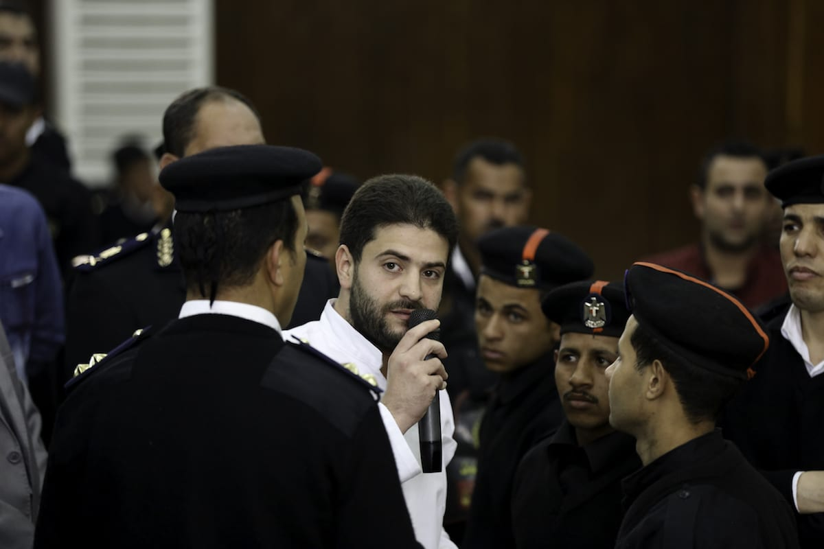 Osama Mohamed Morsi (C), the son of ousted Egyptian president Mohamed Morsi is seen at Cairo Police Academy during the trial session of Rabaa el-Adaweya protest case in Cairo, Egypt on 21 March, 2017 [Moustafa El-Shemy/Anadolu Agency]