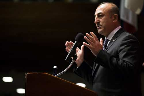 Turkish Minister of Foreign Affairs, Mevlut Cavusoglu (L) delivers a speech on March 21, 2017 [Samuel Corum/Anadolu A