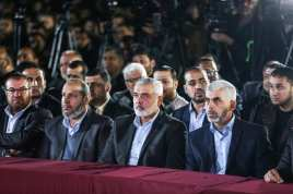 Leader of Hamas in the Gaza Strip Yahya Sinwar (R) and senior political leader of Hamas Ismail Haniyeh (2nd R) attend the memorial ceremony held for Mazen Fuqaha, who was killed by unknown persons, in Gaza City, Gaza on March 27, 2017. ( Mustafa Hassona - Anadolu Agency )