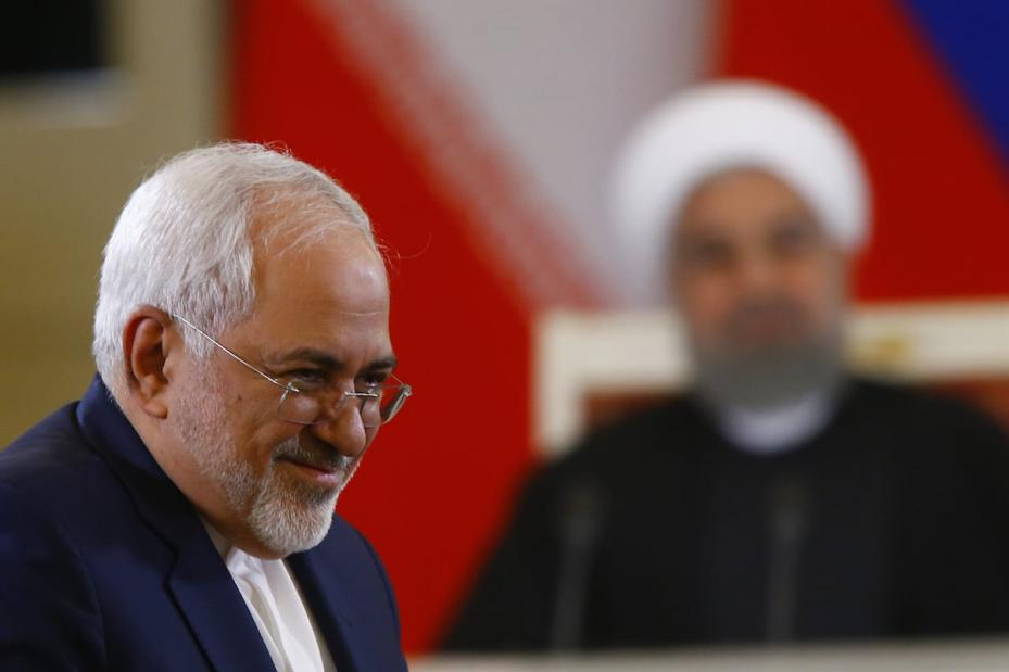Iranian Foreign Minister Javad Zarif attends a joint press conference with Iranian President Hassan Rouhani (rear) and Russian President Vladimir Putin (not seen) after their meeting in Moscow, Russia on March 28, 2017. ( Sefa Karacan - Anadolu Agency )