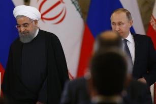 Iranian President Hassan Rouhani (L) and Russian President Vladimir Putin (R) hold a joint press conference after their meeting in Moscow, Russia on March 28, 2017. ( Sefa Karacan - Anadolu Agency )