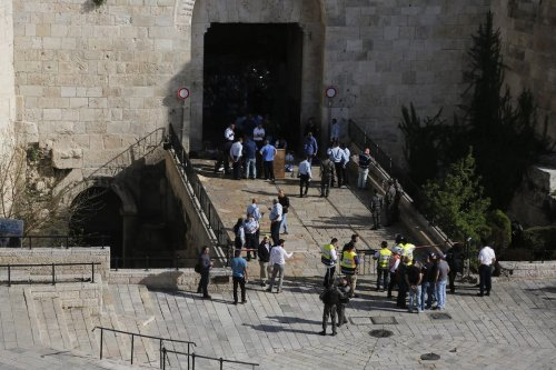 Israeli police gather at a scene where they shot dead a Palestinian woman, who allegedly attempted a knife attack, in front of the Damascus gate in the Old City area of eastern Jerusalem on March 29, 2017. ( Mostafa Alkharouf - Anadolu Agency )