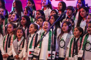 Children perform during the commemoration titled 'Our Land is Our Identity', organized by Culture and Free Thought Association (CFTA) of Palestine, as part of 41st Palestinian Land Day at The Rashad Shawa Cultural Center in Gaza City, Gaza on March 29, 2017 (Mustafa Hassona - Anadolu Agency )