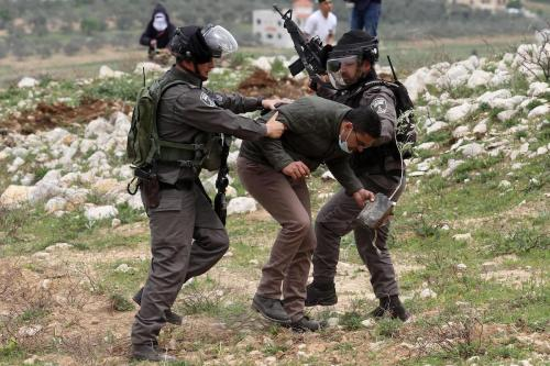 """Israeli soldiers intervene in Palestinians, who gathered for a tree planting event on """"Palestinian Land Day"""", in the Madma village of Nablus, West Bank on March 30, 2017. ( Nedal Eshtayah - Anadolu Agency )"""