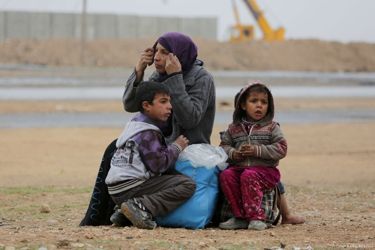 Image of Iraqi women and children who fled from the violence between the Iraqi Army and Daesh terrorists in Mosul, Iraq 2 March 2017 [Yunus Keleş - Anadolu Agency]