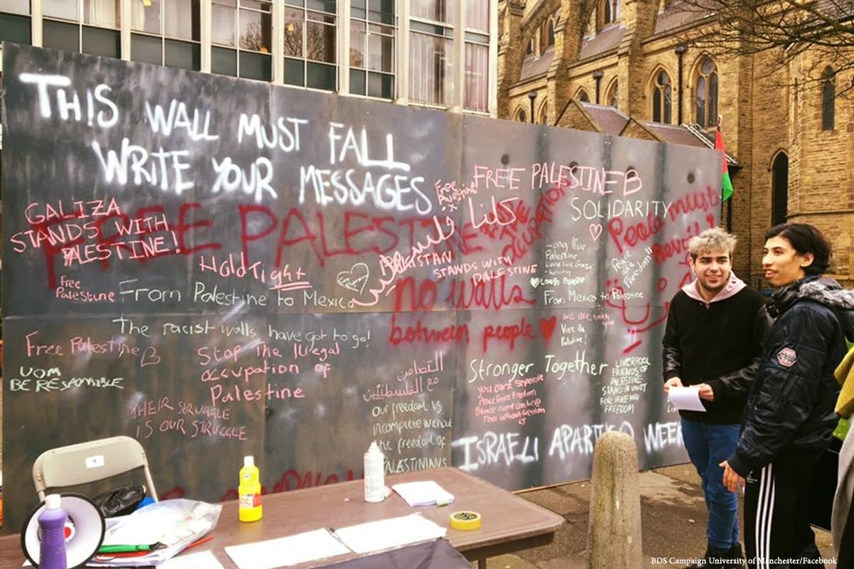 Image of a mock wall representing the apartheid wall in the West Bank during Israel Apartheid Week by the student-led BDS campaign at the University of Manchester on 3 March 2017 [BDS Campaign University of Manchester/Facebook]