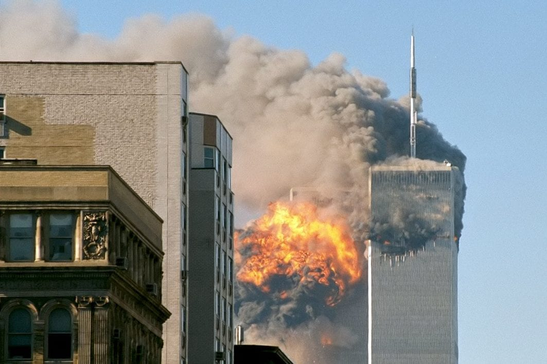 The World Trade Towers in New York after United Airlines Flight 175 crashes into it on September 11 2011 [TheMachineStops/Flickr]