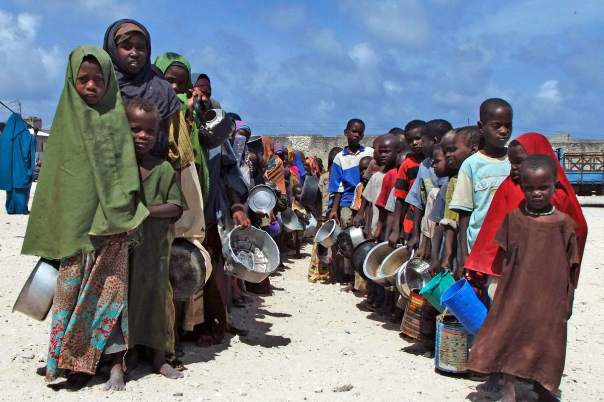 File photo of Somalian children queuing to receive food aid