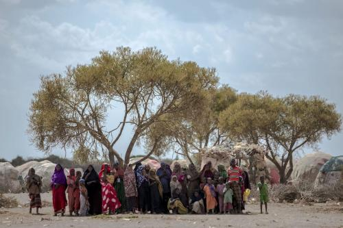 Somalians wait for drinkable water, delivered by non-governmental organizations at a camp in Somalia's Bay state on 4 April, 2017 [Arif Hüdaverdi Yaman/Anadolu Agency]