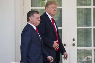 US President Donald Trump and King Abdullah II bin al-Hussein of Jordan emerge from the Oval Office together for a joint press conference in the Rose Garden of the White House in Washington, USA on April 5, 2017. ( Samuel Corum - Anadolu Agency )