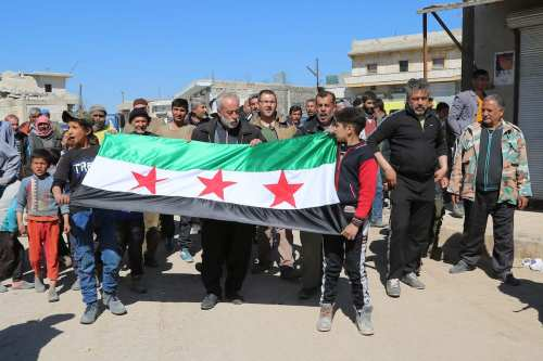 People gather to protest Assad regime forces' suspected chemical gas attack in the opposition-held Syrian province of Idlib, in Aleppo, Syria on April 5, 2017 [Muhammed Nour / Anadolu Agency]
