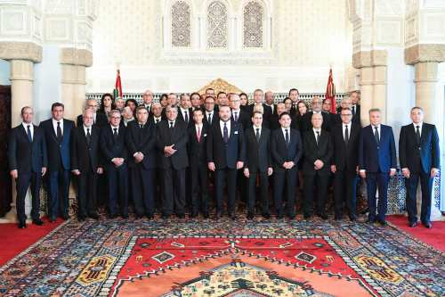 King of Morocco Mohammed VI (7th R) and Head of the National Council of Justice and Development Party (JDP), Saadeddine Othmani (6th R) pose for a family photo with the members of the new cabinet in Rabat, Morocco on April 5, 2017. ( Morocco News Agency / Handout - Anadolu Agency )