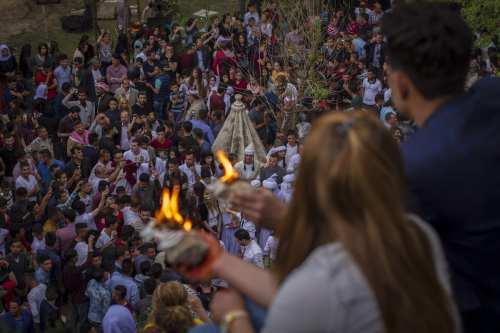 Iraqi Yezidis gather to celebrate Yezidi New Year, known as Chwarshaba Sor or Red Wednesday, in Dohuk, Iraqi Kurdish Regional Government (IKRG) on April 18, 2017. (Muhammet Bamerni - Anadolu Agency )