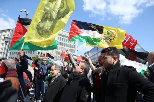 People hold banners and flags as they gather at Schuman Square to protest against Israel in Brussels, Belgium on April 19, 2017 [Dursun Aydemir /Anadolu Agency]
