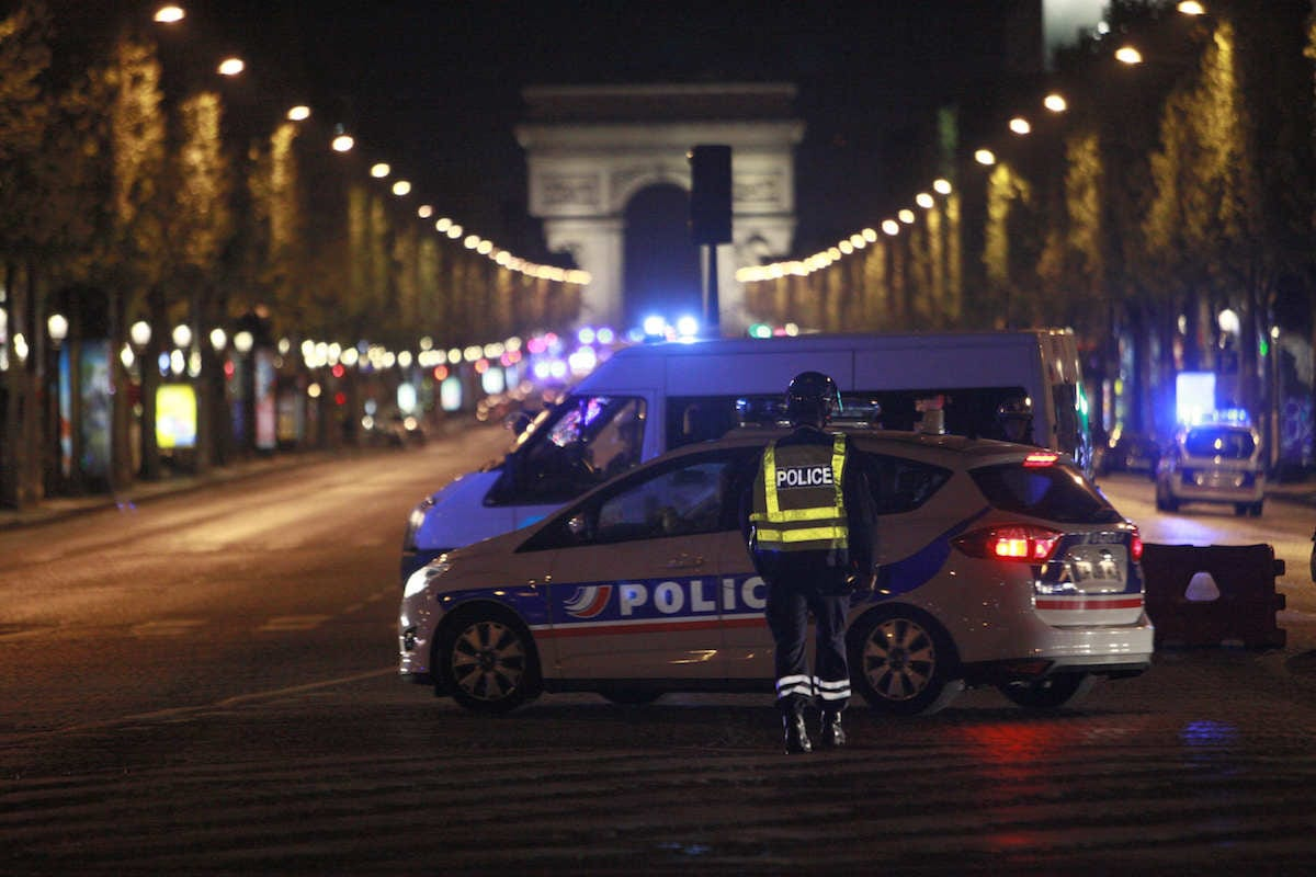 French security forces cordon the area after a gunman attack, killing a police officer at Champs Elysees in Paris, France on April 20, 2017. One police officer was killed and two others were seriously injured Thursday when a gunman opened fire at a police patrol on the famous Champs-Elysees boulevard here, according to the Interior Ministry. ( Raphael Lafargue - Anadolu Agency )