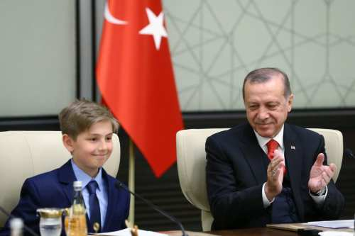 Turkish President Recep Tayyip Erdogan and Yigit Turk, 10-year-old 4th grade student from Mehmet Akif Primary School who represented the President to mark the National Sovereignty and Children's Day, are seen at the meeting hall of the National Security Council (MGK), at Presidential Complex during the National Sovereignty and Children's Day in Ankara, Turkey on April 23, 2017. ( Kayhan Özer - Anadolu Agency )