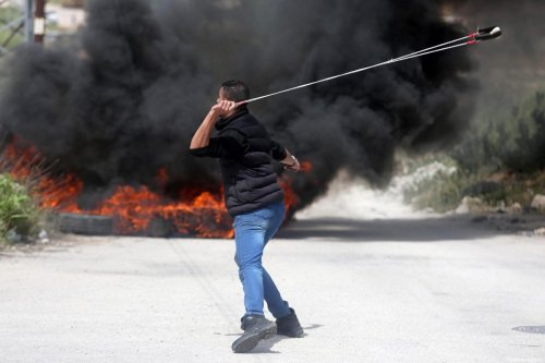 Palestinians clash with Israeli forces at a protest to show solidarity with Palestinians prisoners on hunger strike in Ramallah, West Bank on April 23, 2017 [Issam Rimawi / Anadolu Agency]