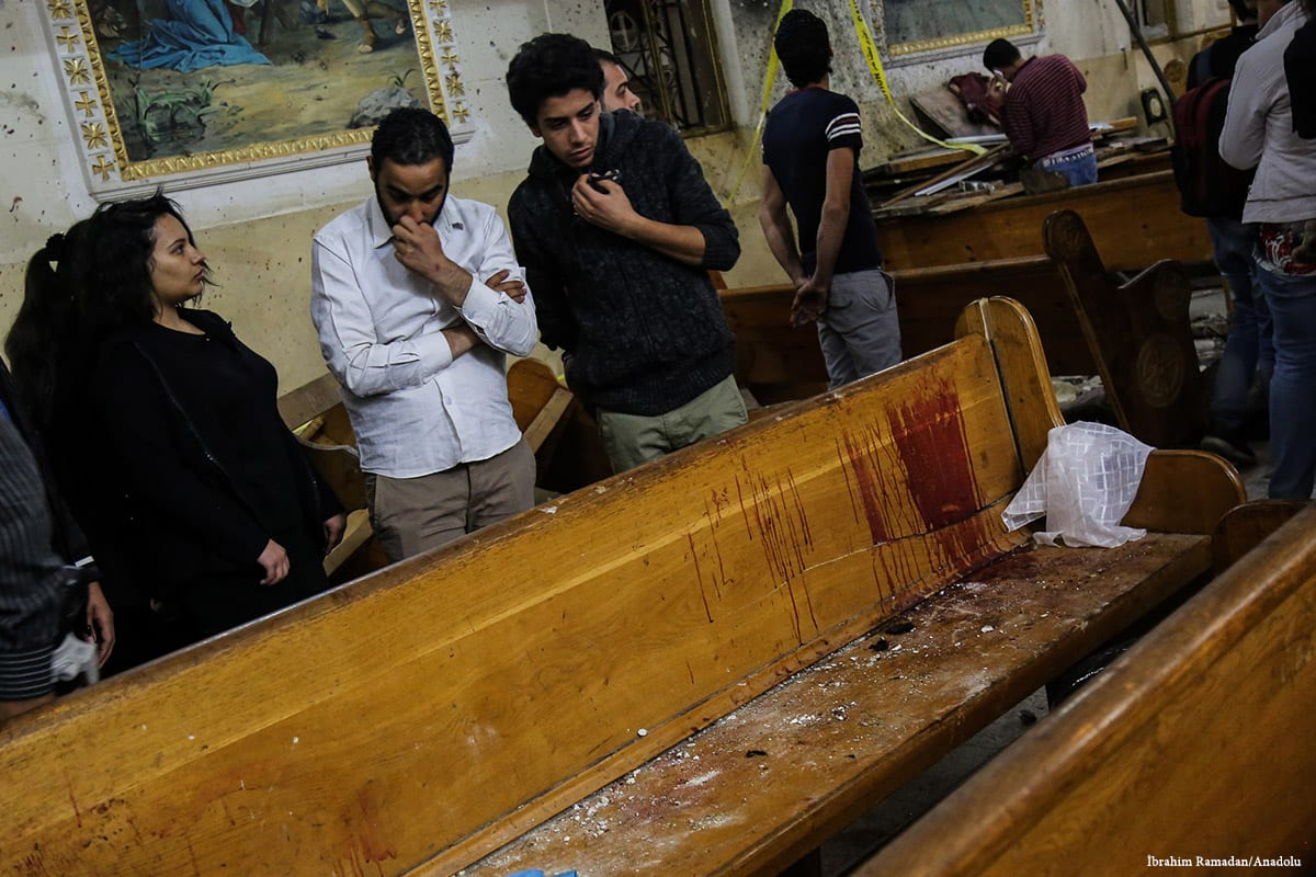 Blood is seen on the benches after a bomb went off inside a church which claimed the lives of 21 people in Tanta, Egypt on 9 April 2017 [İbrahim Ramadan/Anadolu]