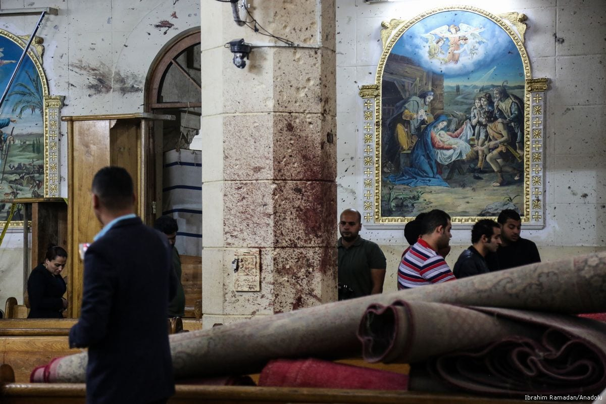People are seen at the damaged Saint George church after a bombing struck inside the church in Egypt on April 9, 2017. ( İbrahim Ramadan - Anadolu Agency )