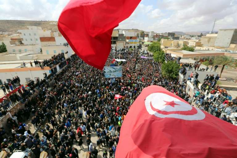 Tunisians wave the national flag in the southern city of Tatouine on 11th April, 2017
