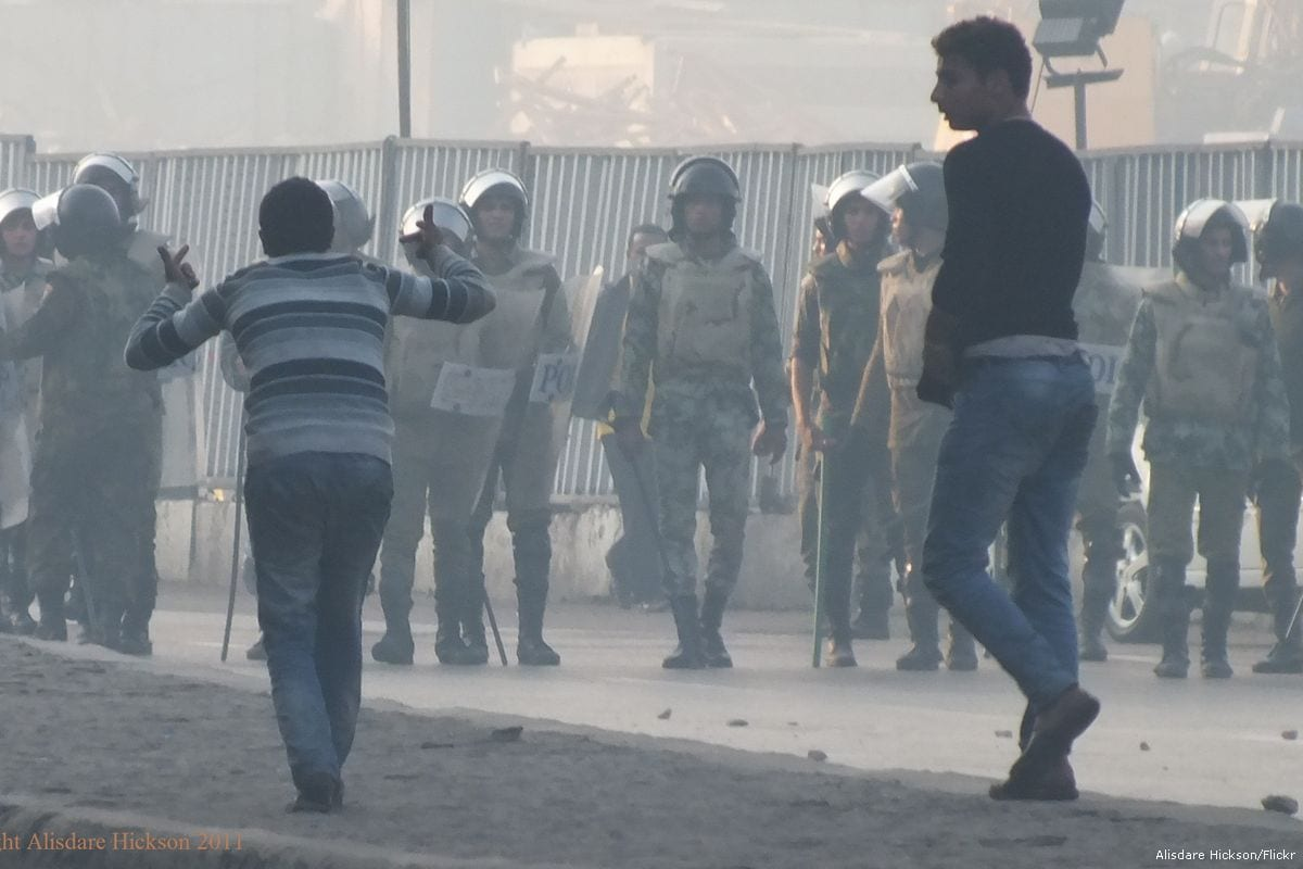 Image of Egyptian police confronting protesters on 17 December 2011 [Alisdare Hickson/Flickr]