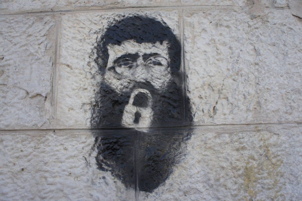 Khader Adnan stencil on a wall by Manara square, Ramallah on February 23, 2012 [Wikipedia]