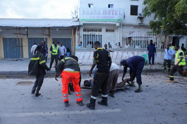 Paramedics prepare to carry bodies after a bomb exploded, in Mogadishu, Somalia on May 8, 2017 [Sadak Mohamed/Anadolu Agency]