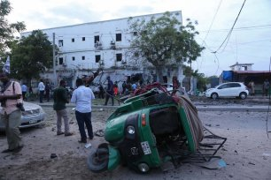A damaged car is seen, after a bomb laden car parked near the Immigration and Citizenship Office exploded, at the explosion site in Mogadishu, Somalia on 8 May 2017. At least 10 people were reported dead. [Sadak Mohamed/Anadolu Agency]