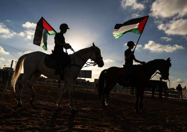 A jockey rides a horse during the equestrian championship held by Aljawad Equestrian Club for children in solidarity with Palestinian hunger-strikers prisoners in Gaza on 11 May, 2017 [Ali Jadallah/Anadolu Agency]