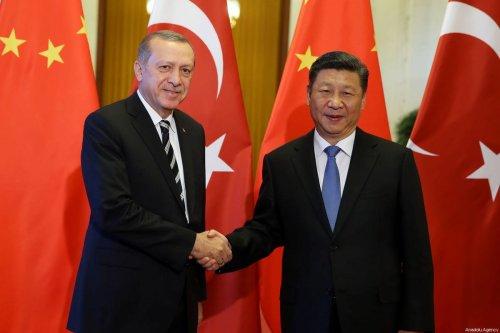 Turkish President Recep Tayyip Erdogan (L) and Chinese President Xi Jinping (R) shake hands during their meeting in Beijing, China on May 13, 2017 [Turkish Presidency / Yasin Bülbül / Anadolu Agency]