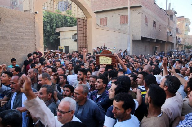 People carry the coffins of Saint Samuel's Monastery attack victims Cercis Mahrous and Beshavi Ibrahim during a funeral ceremony, at Maghagha Church in Cairo, Egypt on May 26, 2017 [Ahmed Al Sayed / Anadolu Agency]