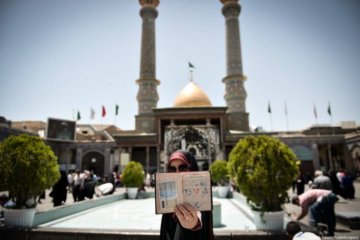 Iranians holding their identity cards as they wait to cast their ballots during Iran's 12th presidential election, at Shah Abdol Azim mosque in Tehran, Iran on 19 May, 2017 [Fatemeh Bahrami/Anadolu Agency]